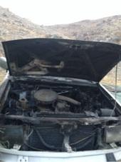 سيارة محترقه فيها ظفيره ومكينه