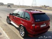 BMW X5 4.8 is 2006 بالون الاحمر المميز والكراسي المميزه