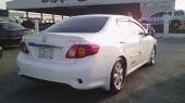 للبيع كورولا 2009 اللون أبيض