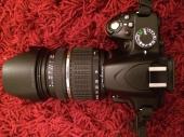 كاميرا نيكون nikon d3200 مع عدسة  18-200mm تم تخفيض الحد