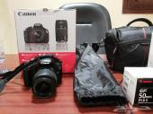 كاميرا كانون d1100 مع عدسة 1.8.50m مع زوم 75 300mمع ترايبود