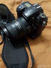 كاميرا نيكون D7000 وعدسة 18-200 II وقريب باتري