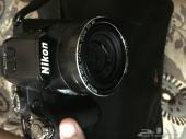 كاميرة nikon coolpix P100 باغراضها للبيع شبه احترافية