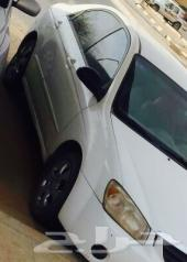 كيا 2006 سيراتو اللون أبيض مناسبة للمستخدم.