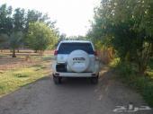 للبيع برادو VX خليجي 2010 وارد الفطيم - أبيض لؤلؤي 105 كم