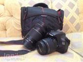 كاميرا كانونD1100 نظيف للبيع مع كام اضافي