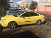 اوبتيما 2008 اللون اصفر مكينه 2000سي سي