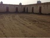 للبيع عقد اجار ارض بها 15 غرفه